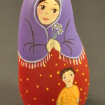 Painted Pebble Nativity. Shepherdess and child.